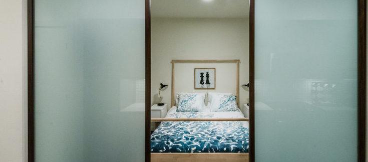 Apartment bedroom with sliding door | 101 Broadway Apartments Capitol Hil